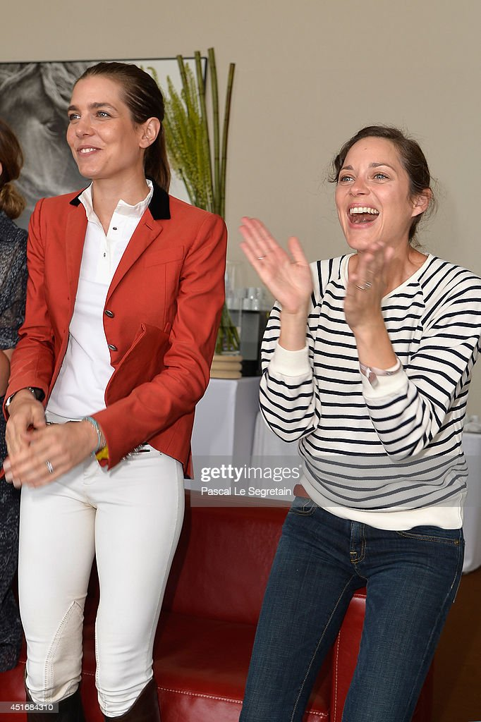 Charlotte Casiraghi and Marion Cotillard attend the Paris Eiffel Jumping presented by Gucci at Champ-de-Mars on July 4, 2014 in Paris, France.