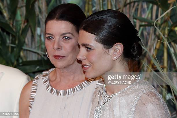 Charlotte Casiraghi and Princess Caroline of Hanover arrive for the annual Rose Ball at the MonteCarlo Sporting Club in Monaco on March 19 2016 The...