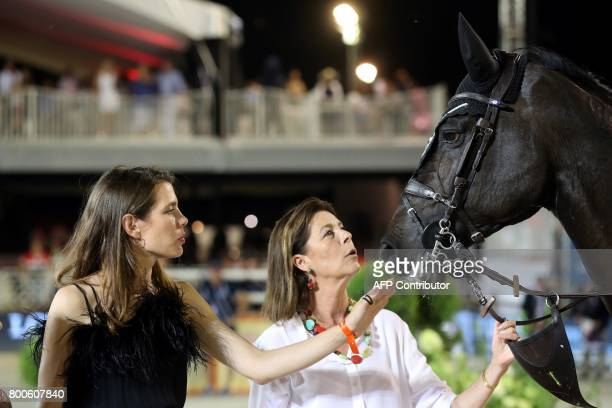 Charlotte Casiraghi and princess Caroline of Hanover look at a horse during a ceremony as part of the 2017 edition of the Jumping International of...