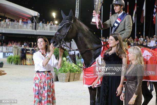 Charlotte Casiraghi and princess Caroline of Hanover stand by a horse during a ceremony as part of the 2017 edition of the Jumping International of...