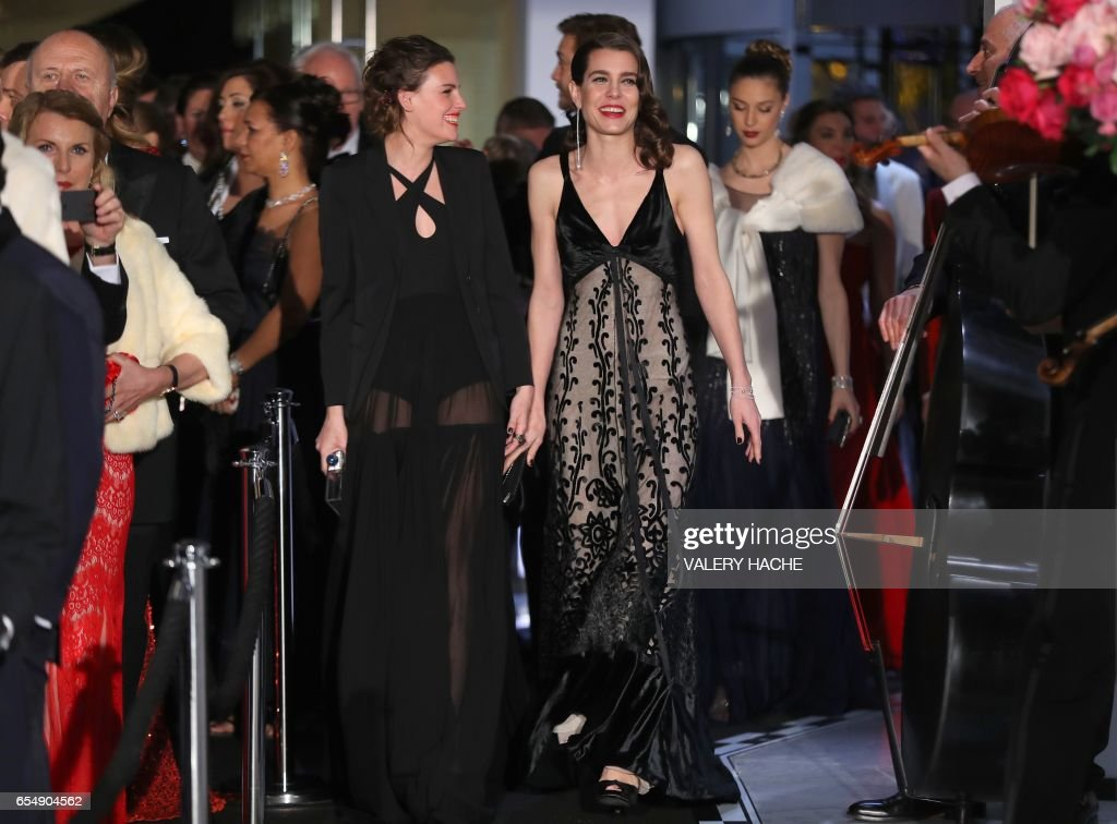 Charlotte Casiraghi (C) arrives for the annual Rose Ball at the Monte-Carlo Sporting Club in Monaco on March 18, 2017. The Rose Ball is one of the major charity events in Monaco. Created in 1954, it benefits the Princess Grace Foundation. /