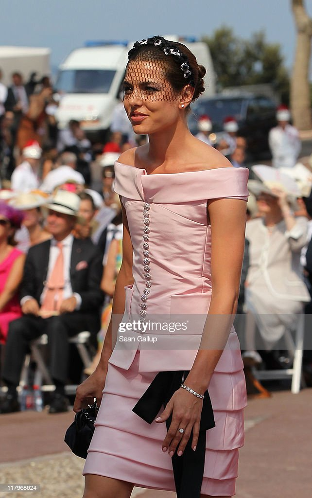 Charlotte Casiraghi attends the religious ceremony of the Royal Wedding of <a gi-track='captionPersonalityLinkClicked' href=/galleries/search?phrase=Prince+Albert+II+of+Monaco&family=editorial&specificpeople=201707 ng-click='$event.stopPropagation()'>Prince Albert II of Monaco</a> to Princess <a gi-track='captionPersonalityLinkClicked' href=/galleries/search?phrase=Charlene+-+Princess+of+Monaco&family=editorial&specificpeople=726115 ng-click='$event.stopPropagation()'>Charlene</a> of Monaco in the main courtyard at the Prince's Palace on July 2, 2011 in Monaco. The Roman-Catholic ceremony follows the civil wedding which was held in the Throne Room of the Prince's Palace of Monaco on July 1. With her marriage to the head of state of the Principality of Monaco, <a gi-track='captionPersonalityLinkClicked' href=/galleries/search?phrase=Charlene+-+Princess+of+Monaco&family=editorial&specificpeople=726115 ng-click='$event.stopPropagation()'>Charlene</a> Wittstock has become Princess consort of Monaco and gains the title, Princess <a gi-track='captionPersonalityLinkClicked' href=/galleries/search?phrase=Charlene+-+Princess+of+Monaco&family=editorial&specificpeople=726115 ng-click='$event.stopPropagation()'>Charlene</a> of Monaco. Celebrations including concerts and firework displays are being held across several days, attended by a guest list of global celebrities and heads of state.