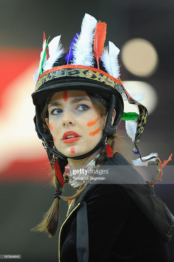 <a gi-track='captionPersonalityLinkClicked' href=/galleries/search?phrase=Charlotte+Casiraghi&family=editorial&specificpeople=206874 ng-click='$event.stopPropagation()'>Charlotte Casiraghi</a> (wearing native american indian dress) attends the Style & Competition for Amade at the Gucci Paris Masters 2012 at Paris Nord Villepinte on December 1, 2012 in Paris, France.
