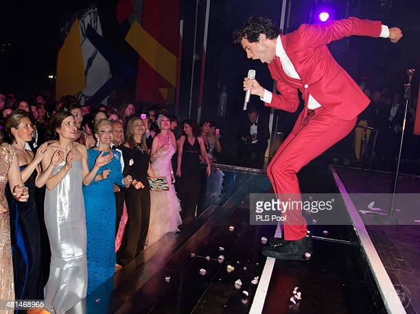 Charlotte Casiraghi looks on as Mika performs during the Rose Ball 2014 in aid of the Princess Grace Foundation at Sporting MonteCarlo on March 29...