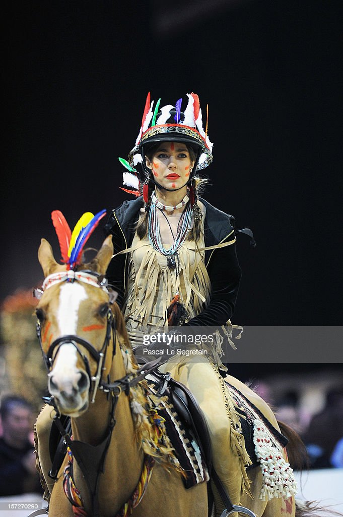 <a gi-track='captionPersonalityLinkClicked' href=/galleries/search?phrase=Charlotte+Casiraghi&family=editorial&specificpeople=206874 ng-click='$event.stopPropagation()'>Charlotte Casiraghi</a> (wearing native american indian dress) rides Rubins Quibelle during the Style & Competition for Amade at the Gucci Paris Masters 2012 at Paris Nord Villepinte on December 1, 2012 in Paris, France.