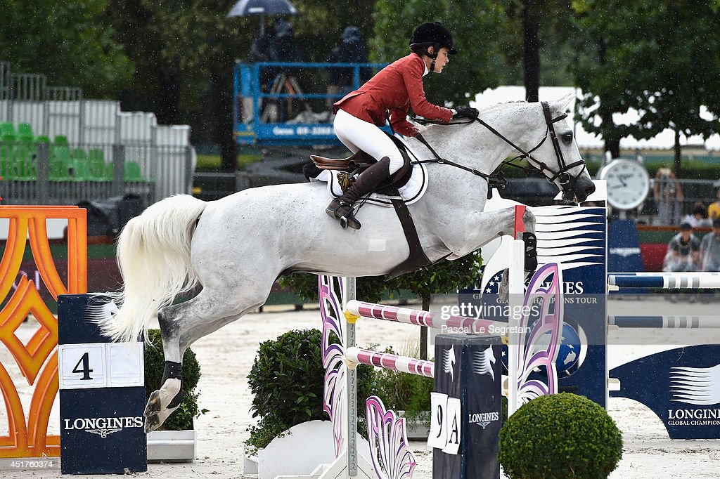 Charlotte Casiraghi rides Tintero during the 'Prize Evian Table A against the clock with jump-off' during the Paris Eiffel Jumping presented by Gucci at Champ-de-Mars on July 6, 2014 in Paris, France.
