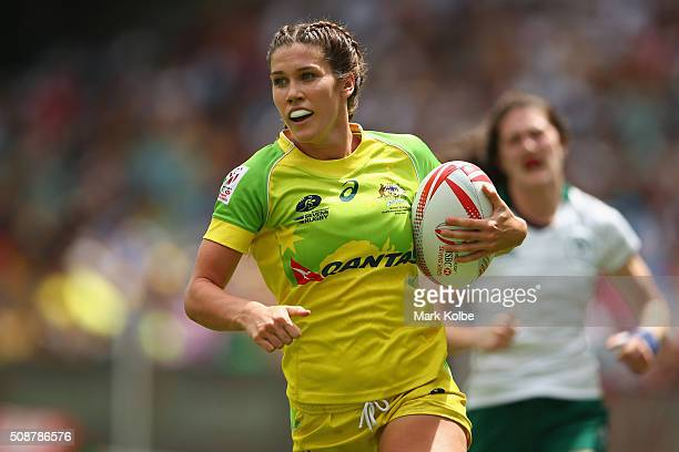 Charlotte Caslick of Australia breaks away to score a try during the 2016 Sydney Sevens internationa friendly womens match between Australia and...