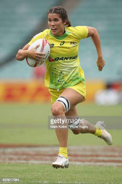 Charlotte Caslick of Australia breaks away to score a try during the womens Pool B match between Australia and Brazil in the 2017 HSBC Sydney Sevens...