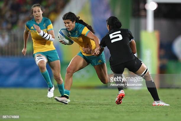 Charlotte Caslick of Australia is tackled by Sarah Goss of New Zealand during the Women's Gold Medal Rugby Sevens match between Australia and New...
