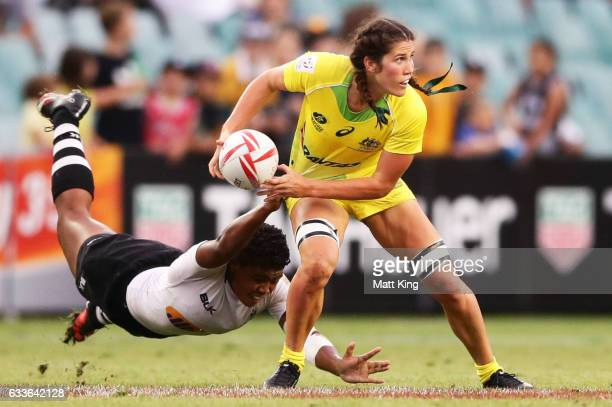 Charlotte Caslick of Australia is tackled during the womens pool match between Australia and Fiji in the 2017 HSBC Sydney Sevens at Allianz Stadium...