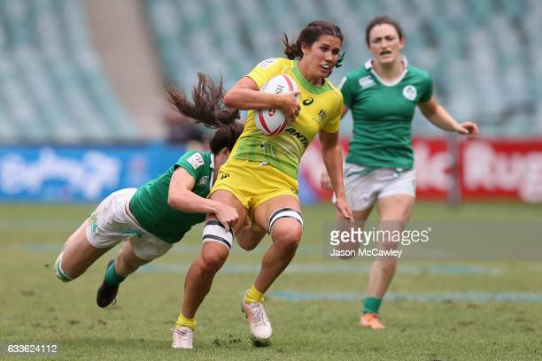 Charlotte Caslick of Australia makes a break during the pool match between Australia and Ireland in the 2017 HSBC Sydney Sevens at Allianz Stadium on...