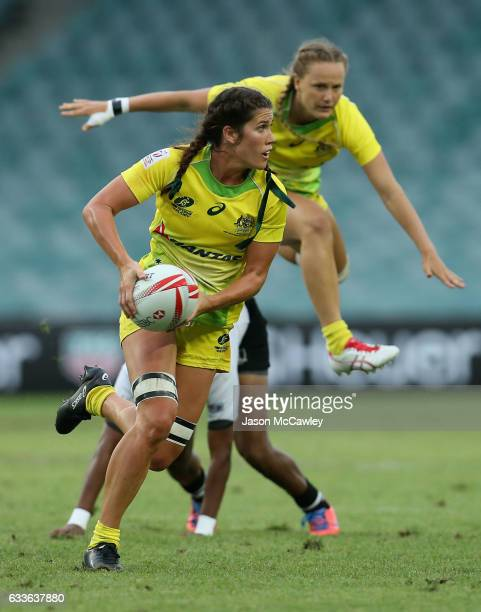 Charlotte Caslick of Australia makes a break during the pool match between Australia and Fiji in the 2017 HSBC Sydney Sevens at Allianz Stadium on...