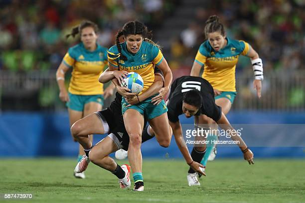 Charlotte Caslick of Australia runs during the Women's Gold Medal Rugby Sevens match between Australia and New Zealand on Day 3 of the Rio 2016...