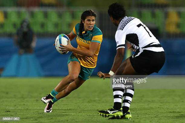 Charlotte Caslick of Australia runs with the ball during a Women's Pool A rugby match between Australia and Fiji on Day 1 of the Rio 2016 Olympic...