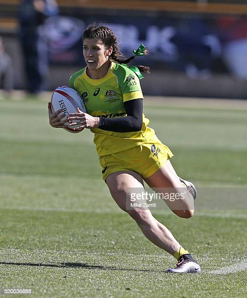 Charlotte Caslick of Australia runs with the ball during the match against Canada at Fifth Third Bank Stadium on April 9 2016 in Kennesaw Georgia
