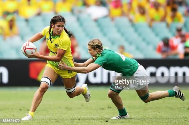 Charlotte Caslick of Australia takes on the defence during the womens pool match between Australia and Ireland in the 2017 HSBC Sydney Sevens at...