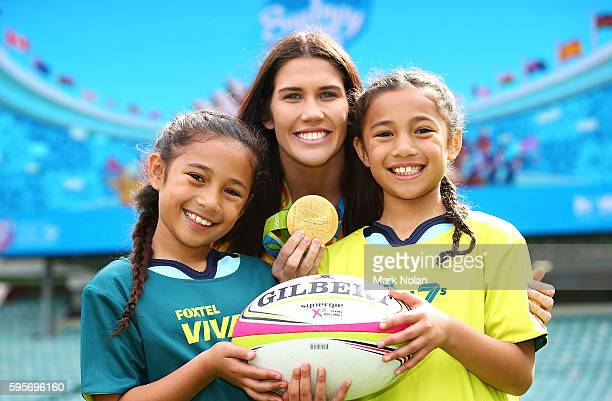 Charlotte Caslick poses for a photo with two young girls during an ARU Sevens media announcement at Allianz Stadium on August 26 2016 in Sydney...