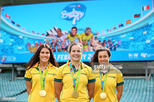 Charlotte Caslick Shannon Parry and Emilee Cherry pose for a photo during an ARU Sevens media announcement at Allianz Stadium on August 26 2016 in...