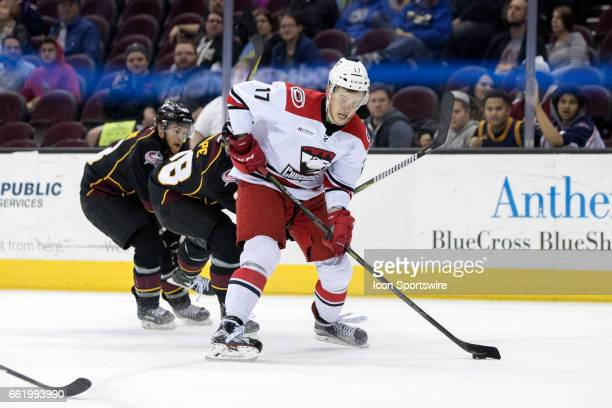 Charlotte Checkers F Andrej Nestrasil controls the puck during the third period of the AHL hockey game between the Charlotte Checkers and Cleveland...