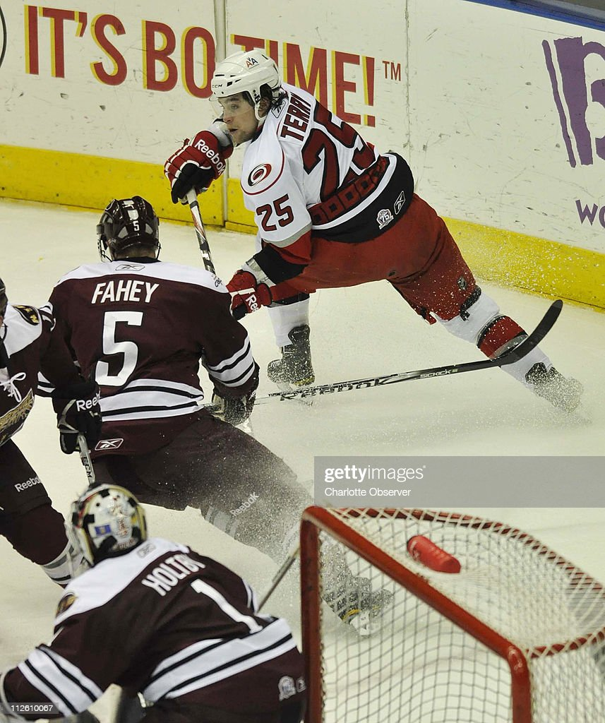 Charlotte Checkers left wing Chris Terry (25) moves the puck ahead of Hershey Bears Brian Fahey (5) during Game 3 of the American Hockey League playoff game at Time Warner Cable Arena, Tuesday, April 19, 2011.