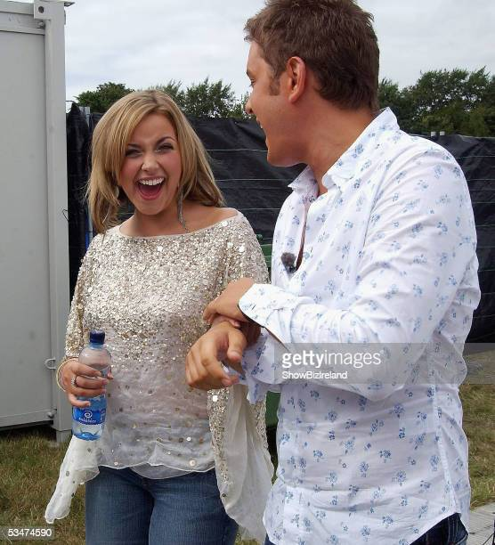 Charlotte Church and Brian Dowling talk backstage during 'O2 in the Park' in Phoenix Park on August 27 2005 in Dublin Ireland