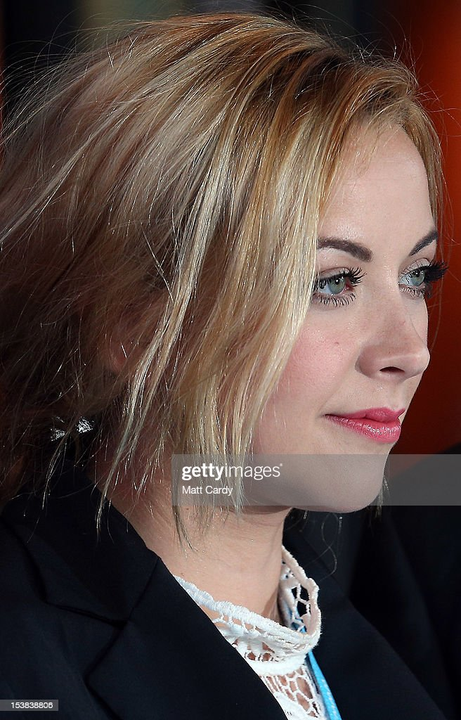 <a gi-track='captionPersonalityLinkClicked' href=/galleries/search?phrase=Charlotte+Church&family=editorial&specificpeople=203217 ng-click='$event.stopPropagation()'>Charlotte Church</a> poses for a photograph as she arrives at the Conservative party conference in the International Convention Centre on October 9, 2012 in Birmingham, England. Today's penultimate day of the annual, four-day Conservative party conference features speeches from Cabinet ministers and the Mayor of London.