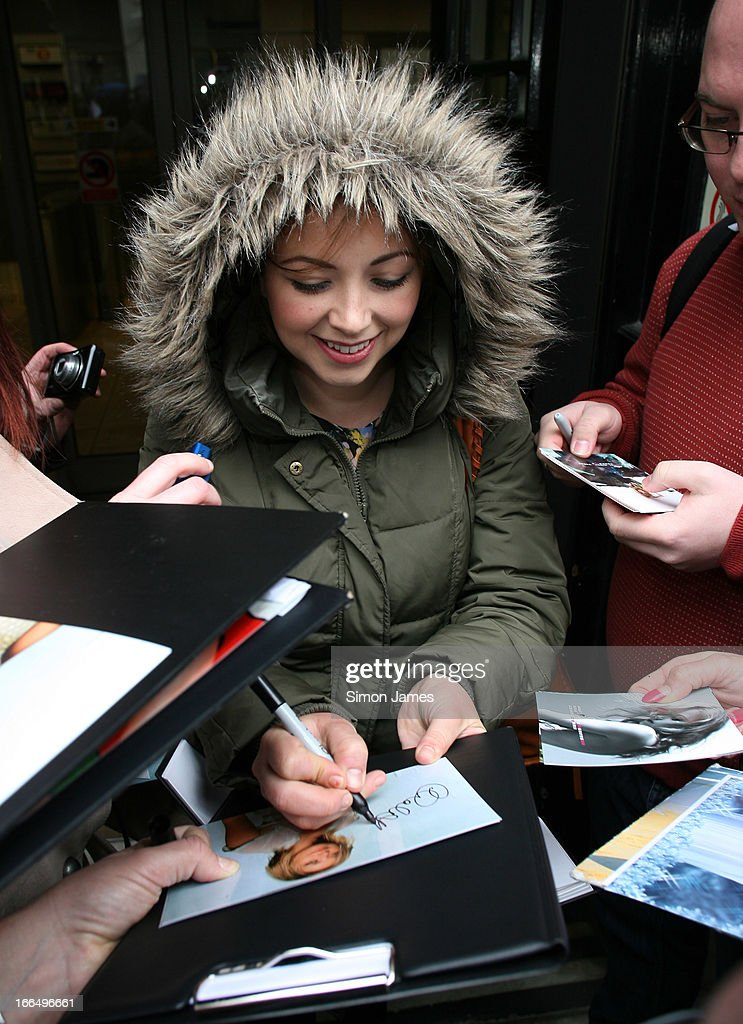 <a gi-track='captionPersonalityLinkClicked' href=/galleries/search?phrase=Charlotte+Church&family=editorial&specificpeople=203217 ng-click='$event.stopPropagation()'>Charlotte Church</a> signs autographs for fans outside BBC Radio 2 studios on April 13, 2013 in London, England.
