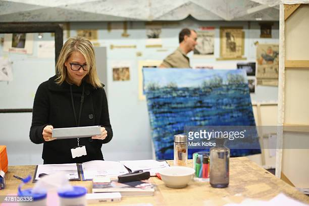 Charlotte Cox Archibald exhibition manager processes an entry after its delivery to the Art Gallery of NSW on June 23 2015 in Sydney Australia...