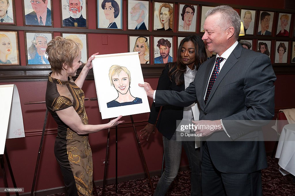 Charlotte d'Amboise Patina Miller and Max Klimavicius attend the Caricature Unveiling for Broadway's 'Pippin' at Sardi's on March 11 2014 in New York...