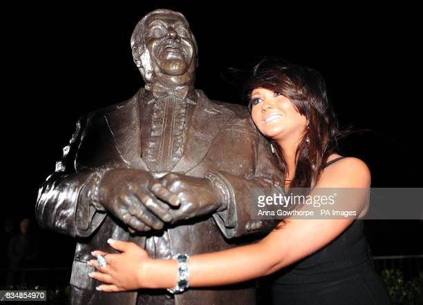 Charlotte Dawson stands by a statue of her late father comedian Les Dawson after it was unveiled by his widow Tracy Dawson at St Annes Pier Lytham St...