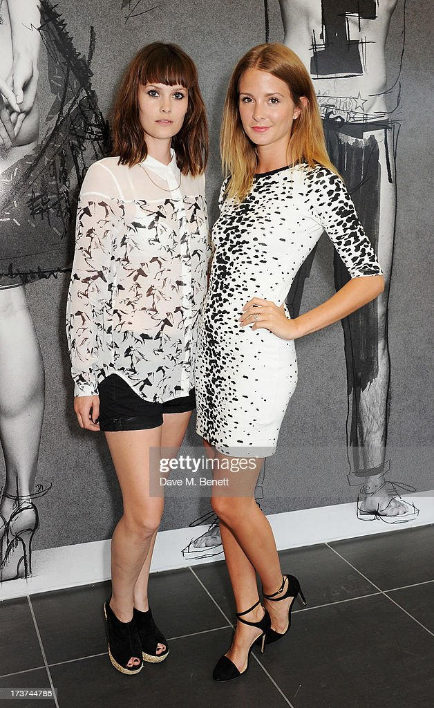 Charlotte De Carle (L) and Millie Mackintosh attend the French Connection x Rankin 'The Full Service' #SketchToStore campaign launch at Rankin Studios on July 17, 2013 in London, England.