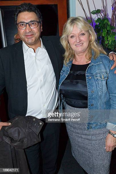 Charlotte de Turckheim and her husband Zaman Hachemi pose in the dressing room of French impersonator Laurent Gerra following his man show at Olympia...