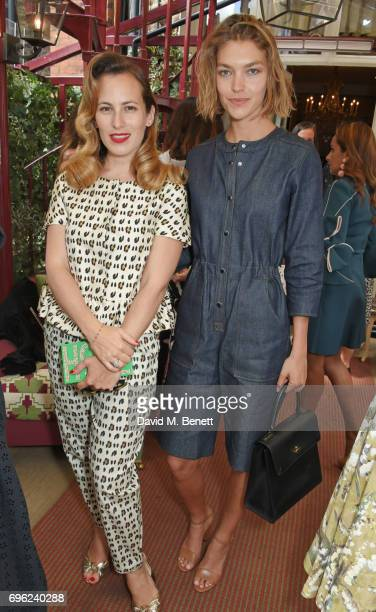 Charlotte Dellal and Arizona Muse attend a lunch to celebrate Veuve Clicquot by Charlotte Olympia at Mark's Club on June 15 2017 in London England