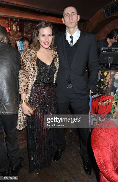 Charlotte Dellal and Dean Stephen attend the launch party of 'Downstairs' new bar opening at Momo Restaurant on February 22 2010 in London England