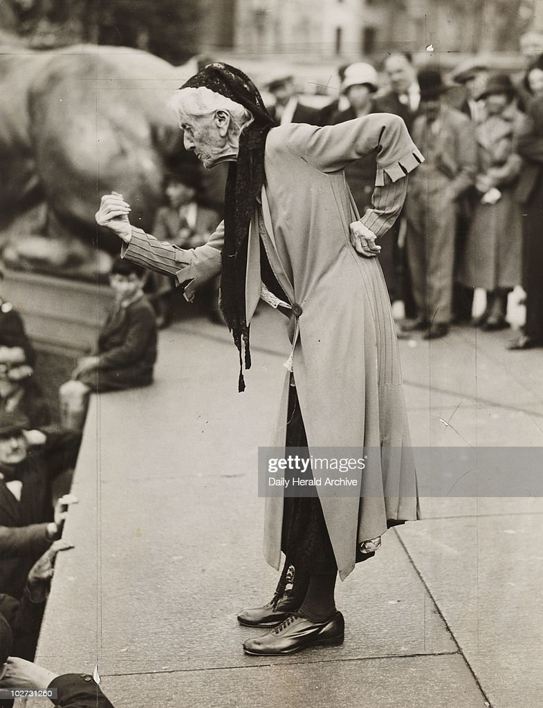 Charlotte Despard speaking at anti-fascist rally, London, c 1930s. Gelatin silver print. Photograph by James Jarche. 'Mrs Despard, the Suffragette, speaking at anti-fascist rally, Trafalgar Square'. Despard (1844-1939), suffragette and social worker, was a tireless campaigner. She became a leader of the Militant Suffragette movement with the Pankhursts, and in 1907 she was arrested during the 'Women's Parliament', demonstration and sentenced to three weeks in prison. She was editor of 'the Vote', and in 1918, she stood as Labour candidate in Battersea. In Ireland she campaigned against the British policy of internment, visited the Soviet Union and fought against fascism until the end of her life.