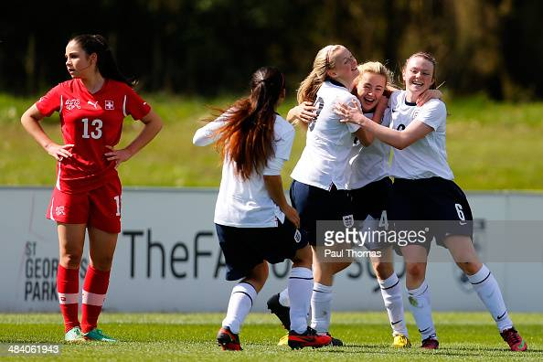 Charlotte Devlin of England celebrates her goal with team mates during the UEFA U16 Women's development tournament match between England and...