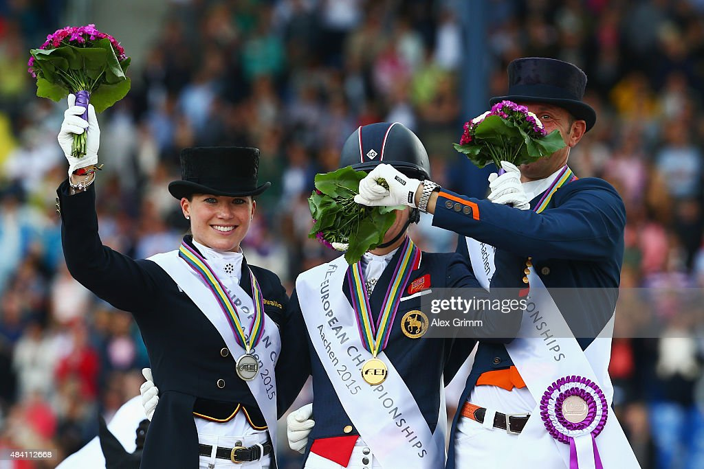 Charlotte Dujardin (C) of Great Britain celebrates winning the Dressage Grand Prix Special Individual Final with second placed Kristina Broering-Sprehe (L) of Germany and third placed Hans Peter Minderhout of the Netherlands on Day 4 of the FEI European Equestrian Championship 2015 on August 15, 2015 in Aachen, Germany.