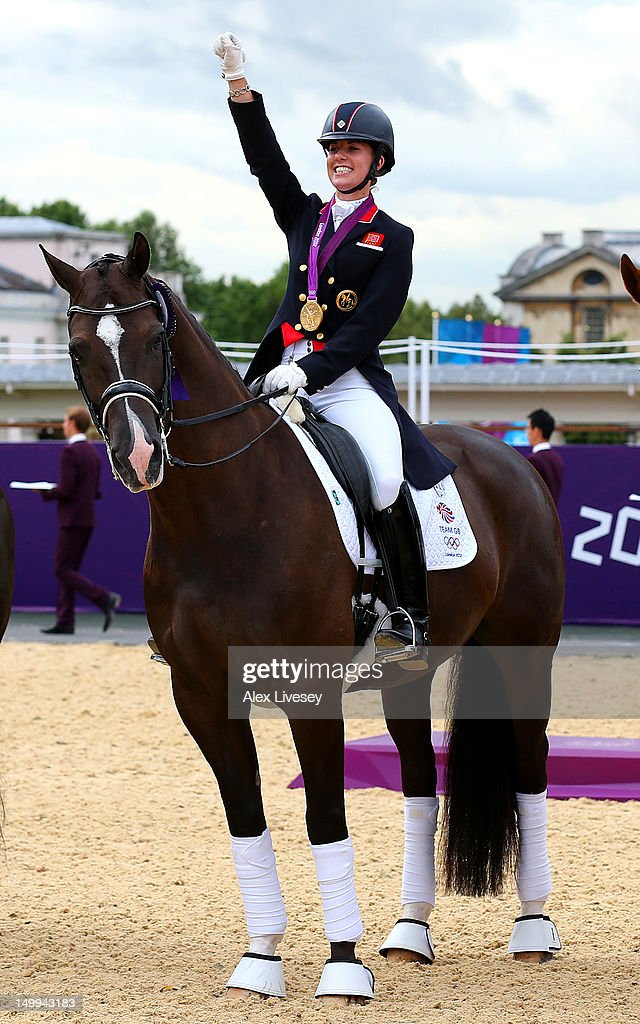 <a gi-track='captionPersonalityLinkClicked' href=/galleries/search?phrase=Charlotte+Dujardin&family=editorial&specificpeople=5426239 ng-click='$event.stopPropagation()'>Charlotte Dujardin</a> of Great Britain on Valegro celebrates with her gold medal during the medal cerermony for the Team Dressage on Day 11 of the London 2012 Olympic Games at Greenwich Park on August 7, 2012 in London, England.