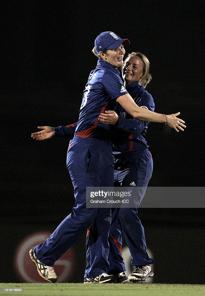 Charlotte Edwards and Dani Wyatt of England celebrate the wicket of Amy Satterthwaite of New Zealand during the Super Sixes ICC Women's World Cup India 2013 match between New Zealand and England at the Cricket Club of India ground on February 13, 2013 in Mumbai, India.