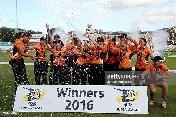 Charlotte Edwards captain of Southern Vipers lifts the trophy with the team after victory in their final match against Western Storm during the Kia...