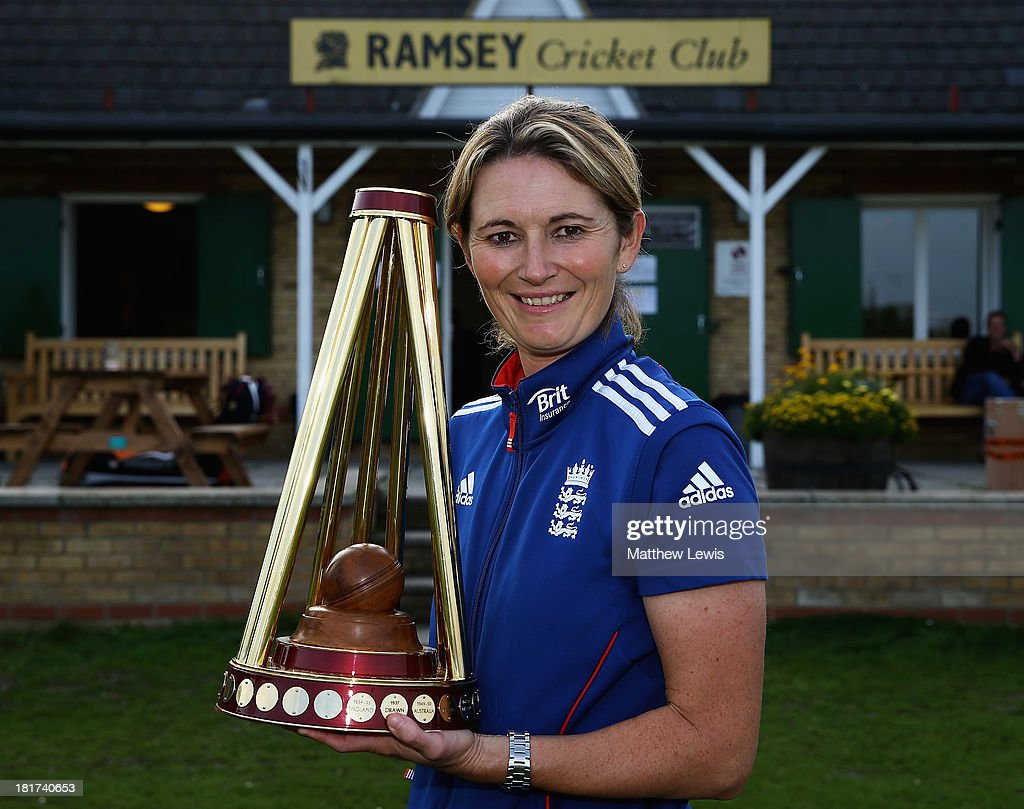 <a gi-track='captionPersonalityLinkClicked' href=/galleries/search?phrase=Charlotte+Edwards&family=editorial&specificpeople=618915 ng-click='$event.stopPropagation()'>Charlotte Edwards</a>, Captain of the England Womens team takes the Ashes Trophy Back to Her Home Club of Ramsey CC on September 24, 2013 in Ramsey, England.