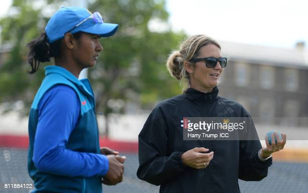 Charlotte Edwards chats with Shikha Pandey of India during the Cricket for Good India event at The County Ground on July 10 2017 in Bristol England