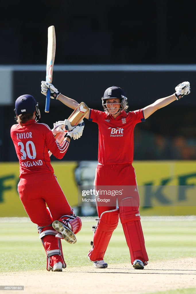 <a gi-track='captionPersonalityLinkClicked' href=/galleries/search?phrase=Charlotte+Edwards&family=editorial&specificpeople=618915 ng-click='$event.stopPropagation()'>Charlotte Edwards</a> (R) of England celebrates hitting the winning runs with <a gi-track='captionPersonalityLinkClicked' href=/galleries/search?phrase=Sarah+Taylor+-+Cricketer&family=editorial&specificpeople=4617790 ng-click='$event.stopPropagation()'>Sarah Taylor</a> during game one of the International Twenty20 series between Australia and England at Blundstone Arena on January 29, 2014 in Hobart, Australia.