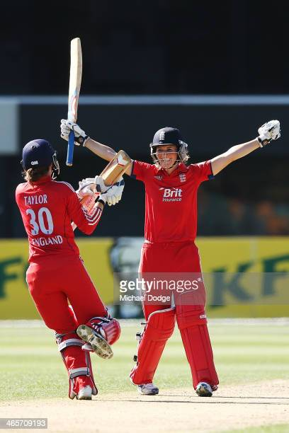Charlotte Edwards of England celebrates hitting the winning runs with Sarah Taylor during game one of the International Twenty20 series between...