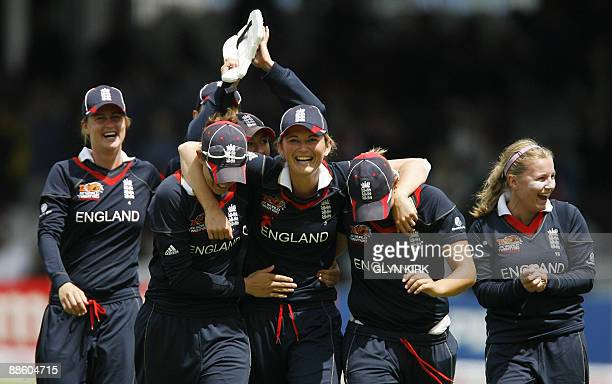 Charlotte Edwards of England leads her team around the pitch after winning the women's final of the ICC Twenty20 Cricket World Cup against New...