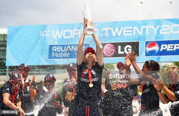 Charlotte Edwards of England lifts the trophy as her team celebrate victory after the ICC Women's World Twenty20 Final between England and New...