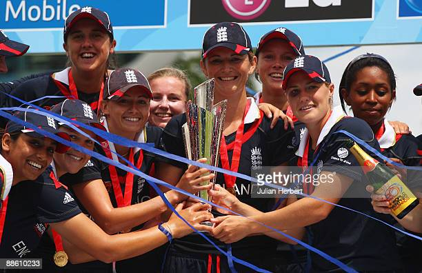 Charlotte Edwards of England lifts the trophy with team mates after the ICC Women's World Twenty20 Final between England and New Zealand at Lord's on...