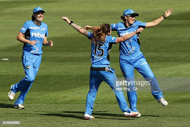 Charlotte Edwards of the Strikers celebrates with team mates after running out Georgia Wareham of the Renegades during the Women's Big Bash League...