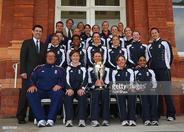 Charlotte Edwards the England captain holds the World Cup trophy with the rest of the England team and Andy Burnham the of Secretary of State for...