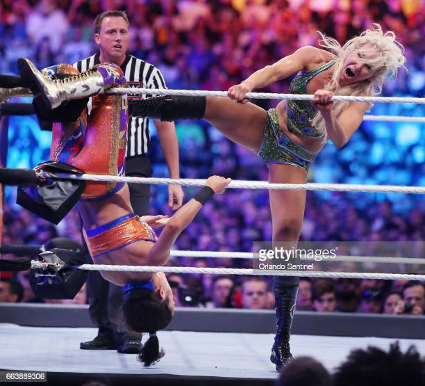 Charlotte Flair right kicks Bayley during WrestleMania 33 on Sunday April 2 2017 at Camping World Stadium in Orlando Fla